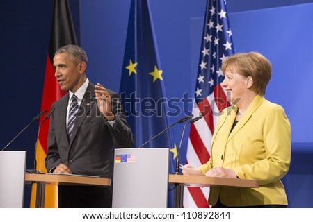 U.S. President Barack Obama and German Chancellor Angela Merkel are pictured during a news conference at the Herrenhausen Palace in Hanover, Germany on April 24, 2016. - stock photo