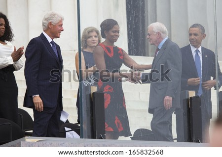 U.S. President Barack Obama, Michelle Obama, Caroline Kennedy, former president Bill Clinton, Oprah Winfrey listen to President Jimmy Carter at Lincoln Memorial August 28, 2013 in Washington, DC.