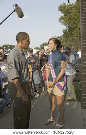 U.S. Senator Barak Obama meeting Miss Iowa State Fair while campaigning for President at Iowa State Fair in Des Moines Iowa, August 16, 2007 - stock photo