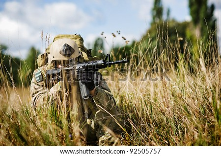 U.S. Soldier in full gear guards his position in Iraq - stock photo