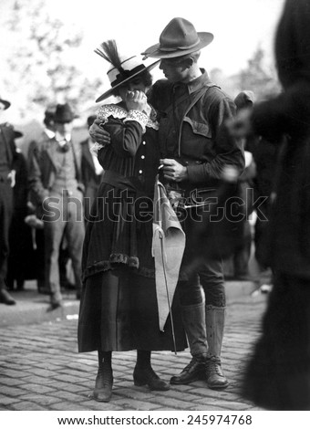 U.S. Soldier saying good bye to his weeping sweetheart. The 71st Regiment Infantry, New York National Guard, was leaving for Camp Wadsworth, Spartanburg, S.C., for basic training. WWI. 1917. - stock photo