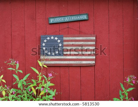 "U.S. wooden flag and sign saying ""pledge allegiance"" - stock photo"