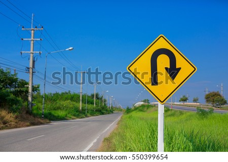 U-turn symbol Road in rustic city in Phitsanulok, Thailand