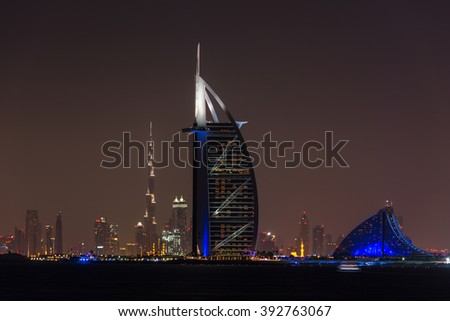 UAE, DUBAI - DECEMBER 26: Night cityscape of Dubai city with Burj Al Arab Jumeirah building on the front, United Arab Emirates on December 26, 2014