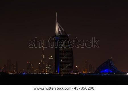 UAE, DUBAI - DECEMBER 26: Night cityscape of Dubai city with Burj Al Arab Jumeirah building on the front, United Arab Emirates on December 26, 2014 - stock photo