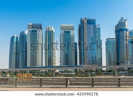 UAE, DUBAI - DECEMBER 31: view of Jumeirah Lakes Towers  and metro bridge in Dubai, United Arab Emirates on December 31, 2014 - stock photo