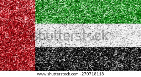 UAE flag on grass background texture - stock photo