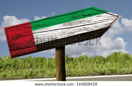 UAE flag wooden sign on the road - stock photo
