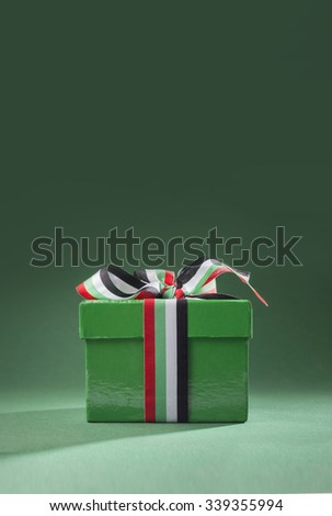 UAE National Day - Small gift box tied with ribbon with UAE national colors. - stock photo