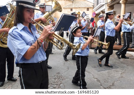 UBEDA, SPAIN -  SEPTEMBER 29: a little boy plays the trumpet in the middle of musicians of a fanfare during the celebrations of the San Miguel, on September 29, 2013, in Ubeda, Spain.  - stock photo
