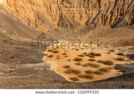 Ubehebe Crater, north tip of the Cottonwood Mountains, Death Valley. The crater is half a mile wide and 500 to 777 feet deep. The age of the crater is estimated from 2,000 to 7,000 years old. - stock photo