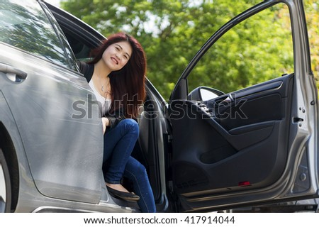 Uber concept: Asian Girl happy smiling in a car - stock photo