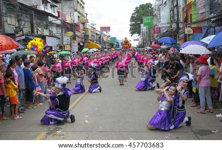 UBON RATCHATHANI, THAILAND - JULY 20: Many people watch good looking boys and girls dance in Candle Festival (Ubonratchathani Candle Festival 2016) on July 20, 2016, UbonRatchathani, Thailand