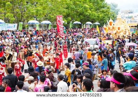 UBONRATCHATHANI, THAILAND - JULY 23: Many people watch beautiful girl dance in Candle Festival (Ubon Candle Festival 2013) on July 23, 2013, UbonRatchathani, Thailand