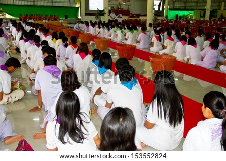 UBONRATCHATHANI, THAILAND - JULY 25: People give food offerings in the morning for Magha Puja Day. on July 25, 2013 Ubonratchathani Thailand.