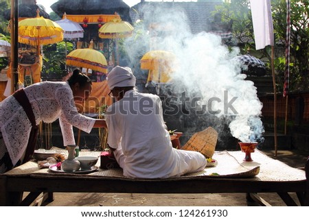 UBUD, BALI, INDONESIA- DECEMBER 26: Unidentified Balinese monk at a family praying ceremony at family home shrines on December 26, 2012 in Ubud, Bali, Indonesia.