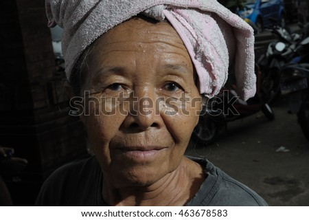 UBUD, BALI, INDONESIA - MARCH 19, 2012 : Unidentified old poor woman to Bali island. Inhabitants of Bali are kind and friendly even in old age