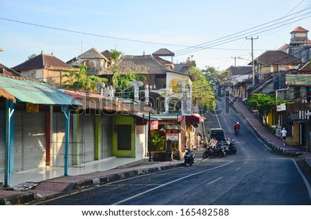 UBUD, BALI, INDONESIA - OCT 17: Tourist area street with restaurants, cafes and shops on October 17, 2013 in Ubud, Bali, Indonesia. Ubud is popular tourist attraction. - stock photo