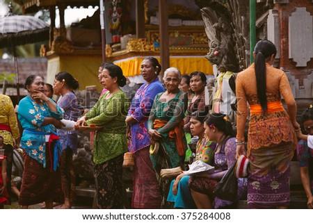 UBUD, BALI, INDONESIA - OCTOBER 23:: People in balinese temple during Galungan Festival on October 23, 2013 in Ubud, Bali, Indonesia - stock photo