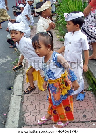 UBUD, INDONESIA - CIRCA MARCH 2008:  Children lined up for the Oga-oga parade