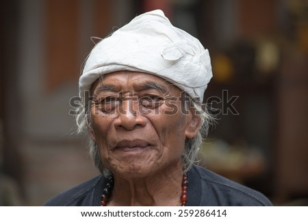 """UBUD, INDONESIA - MARCH 10, 2015 : Portrait Ketut Liyer, traditional healer, who starred in the movie """" Eat Pray Love """" with Julia Roberts in 2010 - stock photo"""