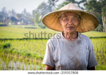 Ubud, Indonesia - September 5: An unidentified Balinese rice farmer poses during a morning's work near Ubud, Bali, Indonesia, on September 5th 2014.