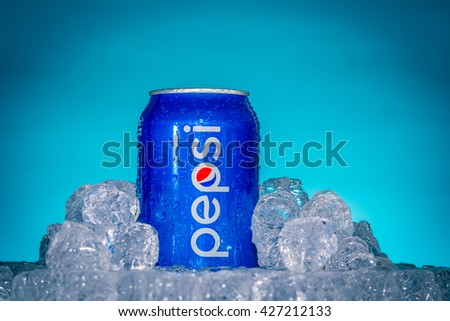 UCCA, ITALY-AUGUST 20, 2015: Can of Pepsi cola on ice. Pepsi is a carbonated soft drink that is produced and manufactured by PepsiCo. Created and developed in 1893.