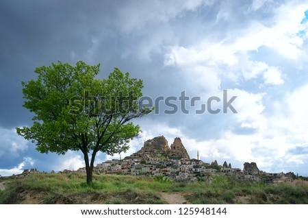 Uchisar Castle cave houses in Cappadocia, Turkey - stock photo
