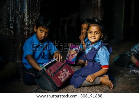 UDAIPUR - MARCH 25 : children posing in the street on March 25 , 2014 in Udaipur,India - stock photo
