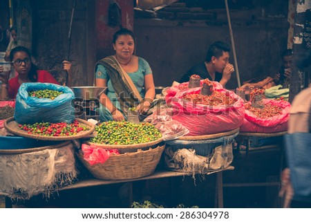 UDAIPUR, RAJASTAN / INDIA - MAY 27 2013 - Unidentified people selling vegetables on the streets. - stock photo