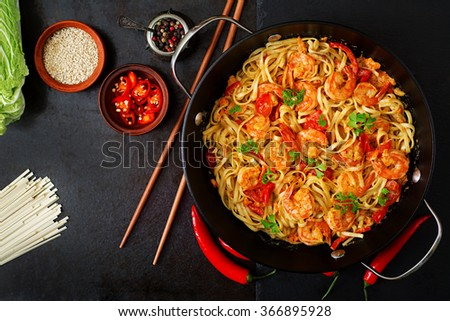 Udon  pasta with shrimp, tomatoes and paprika. Top view - stock photo