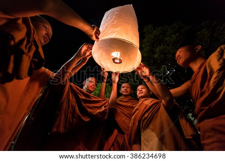 UDON THANI, THAILAND-FEB 22 : The monks hold light floating balloon made of paper annually at Makha Bucha. Same Loy Krathong festival in Chiang mai. On February 22, 2016 in Udon Thani, Thailand.