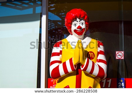 UDON THANI,Thailand - June 10 :View of Ronald McDonald in front of a McDonald's outlet in the city centre on July 11, 2013 in Bangkok, Thailand.  - stock photo