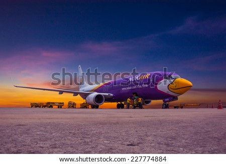 Udon Thani , THAILAND - October 30,2014:  Nok Air Flight at Udon Thani Airport on Oct 30, 2014 inUdon Thani, Thailand. Nok Air is the budget airline of Thai Airways International. - stock photo