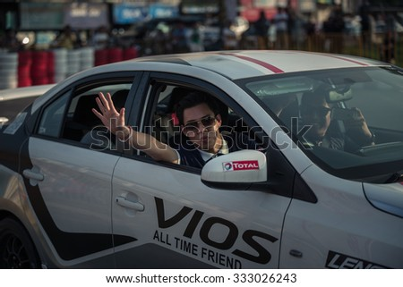 Udon Thani, Thailand - October 18, 2015: the unidentified driver of Toyota Vios waving hand after perform drifting at the event Toyota Motor Sport show