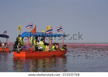 UDONTHANI, THAILAND - JANUARY 31 : Tourist boat travel for see pink lotus lake on January 31, 2015 in Nong Han Udonthani, Thailand - stock photo
