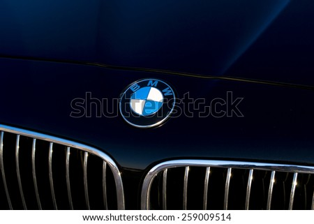 UFA/BASHKORTOSTAN - RUSSIA 4th March 2015 - A sleek black BMW symbol and a car bonnet - stock photo