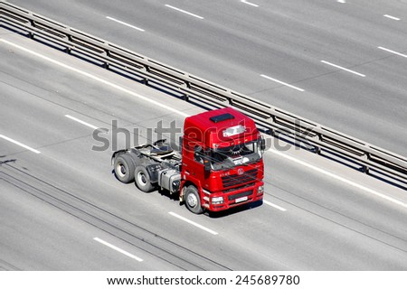 UFA, RUSSIA - JUNE 21, 2014: Modern chinese semi-trailer truck Shaanxi F3000 at the interurban freeway.