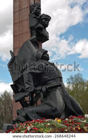 UFA,RUSSIA - MAY 9:  Flowers near Memorial to the Heroes of the Soviet Union Alexander Matrosov and M. Gubaidullin. World War II Memorial. May 9, 2013 Ufa, Russia.  - stock photo