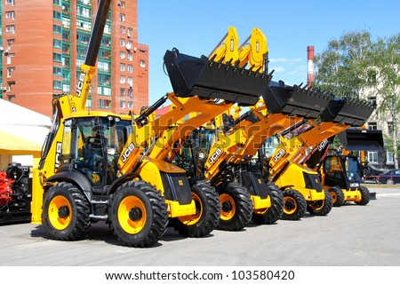 "UFA, RUSSIA - MAY 22: Line of JCB machinery at the annual International exhibition ""Gas. Oil. Technologies"" on May 22, 2012 in Ufa, Bashkortostan, Russia. - stock photo"