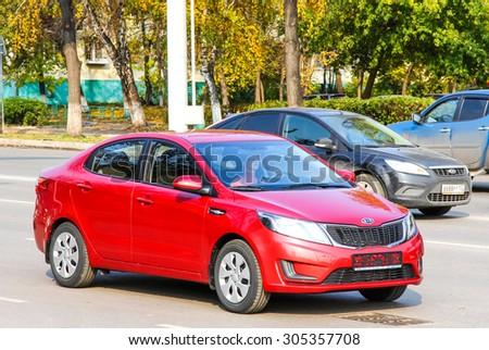 UFA, RUSSIA - OCTOBER 9, 2011: Motor car Kia Rio at the city street. - stock photo