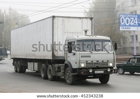 UFA, RUSSIA - OCTOBER 9, 2010: Semi-trailer truck Kamaz 5410 in the city street during a heavy fog. - stock photo