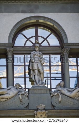 Uffizi gallery in Florence, Italy. Detail of window and statue.