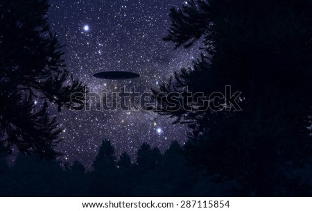 Ufo in night forest - stock photo