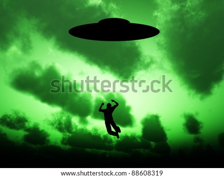 UFO that is abducting a person. - stock photo
