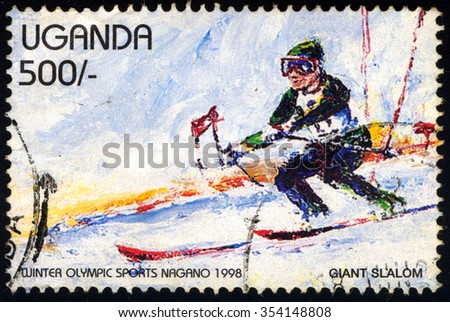 UGANDA - CIRCA 1998: A stamp printed in Uganda dedicated to Winter Olympic Sport Nagano 1998 shows Giant Slalom, circa 1998