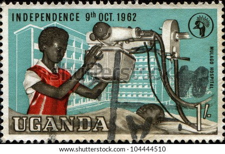 UGANDA - CIRCA 1962: A stamp printed in Uganda shows Doctor makes an X-ray in  Mulago Hospital, circa 1962 - stock photo