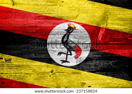 Uganda Flag painted on old wood plank texture
