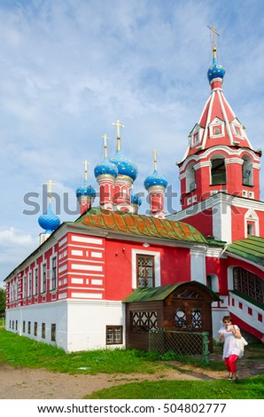 UGLICH, RUSSIA - JULY 19, 2016: Unknown woman is near Church of Tsarevich Dmitry on Blood, Uglich, Russia