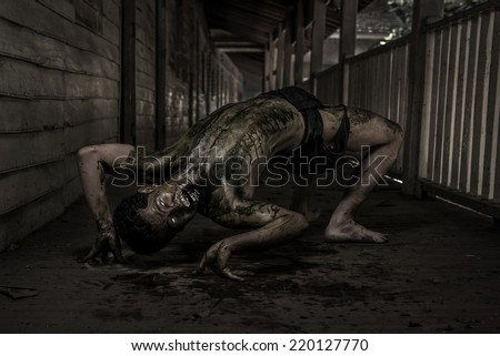 Ugly Zombie man in haunted house - stock photo